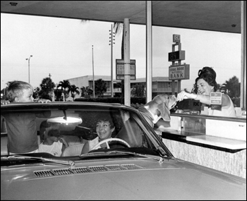 Dog receiving a treat at the Coral Ridge National Bank drive thru window: Fort Lauderdale, Florida (ca. 1969)