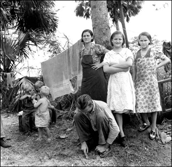 Migrant agricultural worker and his family: Canal Point, Florida (1939)