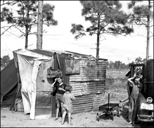 Migrant family at their shelter: Winter Haven, Florida (1937)