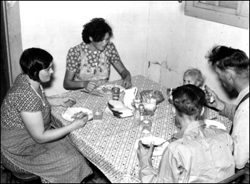 Family of migrant workers having supper