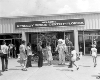 Costumed Spaceman greets tourists at Kennedy Space Center: Cape Canaveral, Florida (19--)