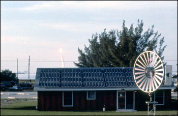 View of space shuttle launch behind renewable energy technologies of the Florida Solar Energy Center: Cape Canaveral, Florida (not before 1981)