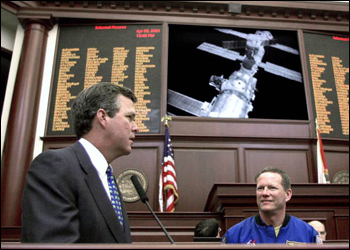 Governor Bush and astronaut David Brown conversing with astronauts at the International Space Station from the Florida House chamber: Tallahassee, Florida (2001)