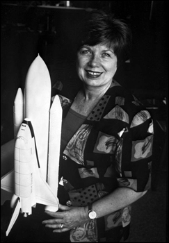 JoAnn Hardin Morgan, posing with space shuttle model (1995)
