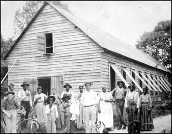 Magnus Delacy Peavy and his farm hands in front of a tobacco barn: Havana, Florida (ca. 1910s)