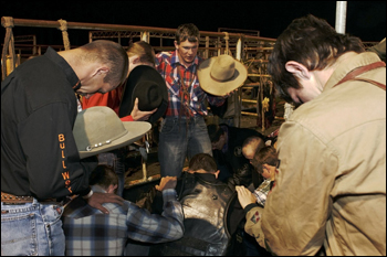 Praying bull riders. Williston Horseman's Park, March 2007.