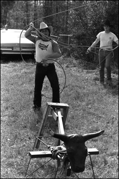 Man practicing for the rodeo roping with a dummy: Macclenny, Florida (1984)