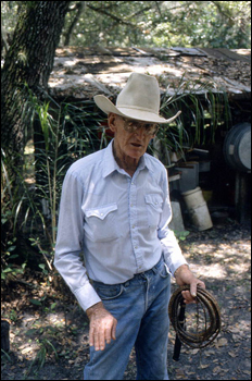 Cow whip maker George &quot;Junior&quot; Mills holding whip: Okeechobee, Florida (1994)