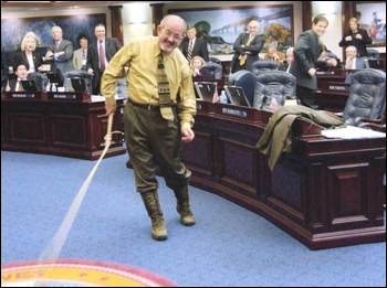 "Rep. Dwight Stansel, D-Live Oak, demonstrates as part of ""Boot Day"" activities his bull whip expertise on the House floor during the 2005 Legislature (2005)"