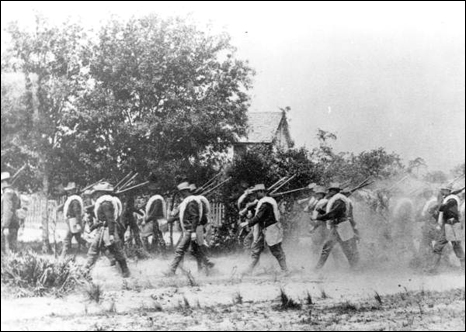 Company B of the 21st Infantry on a dusty march during the Spanish-American war (1898)