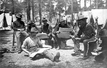 Company E of the 9th Infantry reading newspapers during the Spanish-American war (1898)