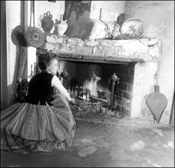 Woman beside the fireplace at the oldest house: Saint Augustine, Florida (1964)