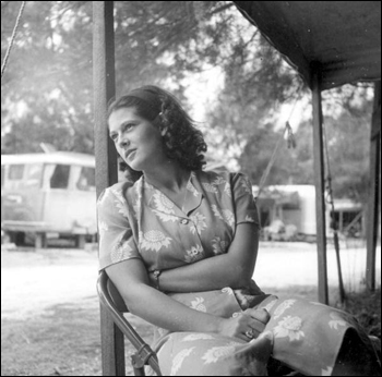 Roey Stickles sits out on the porch in the trailer park: Sarasota, Florida (1946)