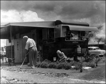 Unidentified couple tends to their yard at Trailer Estates: Sarasota, Florida (1967)