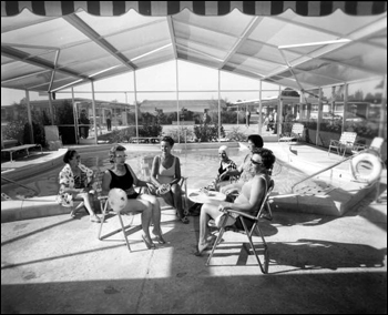 Ladies sit near the community swimming pool: Fort Lauderdale, Florida (1967)