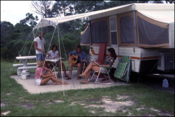People picnicking near camper at St. Andrews State Park: Panama City, Florida (1977)