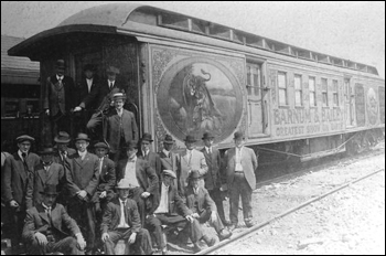 Men standing by Barnum & Bailey Circus railroad car (19__)