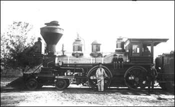 Boys and crew posed with Florida Railway and Navigation Company engine number 16 (ca. 1886)