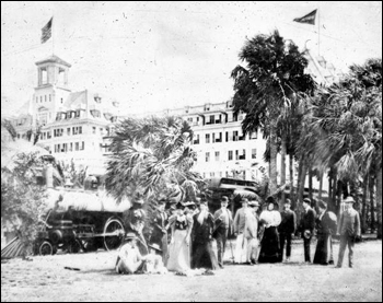 Royal Poinciana guests standing beside the hotel train (1896)