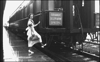 Unidentified woman boarding the Orange Blossom Special train: Sebring, Florida (ca. 1930)