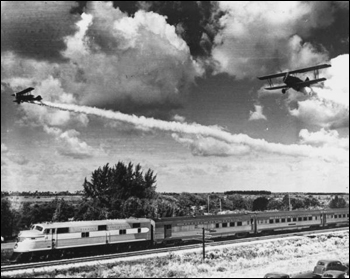 Planes flying over new streamliner (1939)
