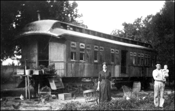 Family using a railroad car of the Tavares and Gulf Railroad as a home: Tavares, Florida (ca. 191_)