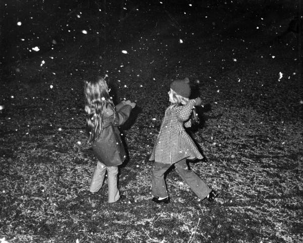 Liz Minerva, left, playing in the snow with Leslie Dughi in Tallahassee, Florida