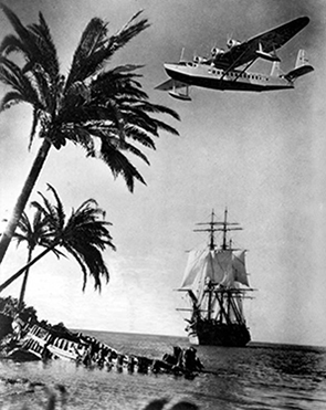 Sikorsky S-42 plane flying over a sailing galleon - Miami, Florida