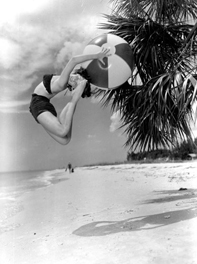Barbara Hughes cutting a back flip with beach ball (black ballet fashion) - Saint Petersburg Beach, Florida