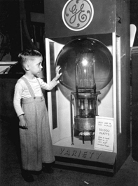 Tommy Dodgen, age 4, standing by the largest lamp in the world - Tampa, Florida