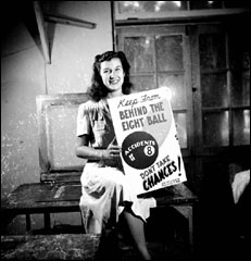 Woman posing with a completed silkscreen print (ca. 1940)
