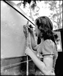 Painting logo on truck : Ocala, Florida (ca. 1940)