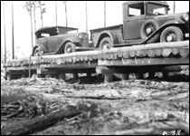 Automobiles on timber bridge: Columbia County, Florida (1933)