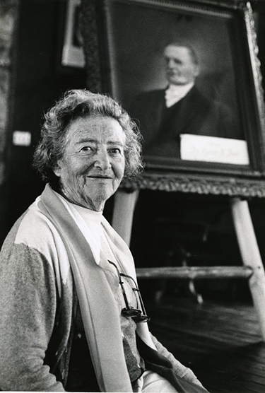 Hedwig Michel with portrait of Cyrus Teed in background