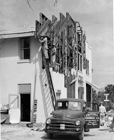 Koreshan Unity building with office, general store and Riverview Inn restaurant undergoing alterations, ca. 1950s