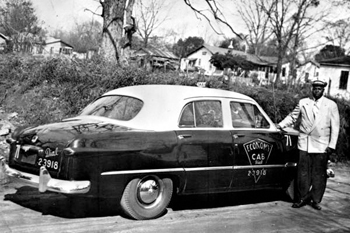 Seth Gaines and his taxi: Tallahassee, Florida (195-)
