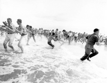"Segregationists trying to prevent blacks from swimming at a ""White only"" beach (1964)"