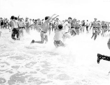 "Segregationists trying to prevent blacks from swimming at a ""White only"" beach: Saint Augustine: Florida (1964)"