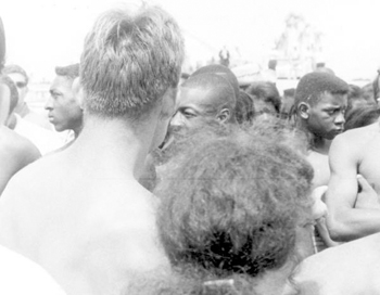 "Segregationists and black demonstrators at a ""white only"" beach: Saint Augustine, Florida (1964)"