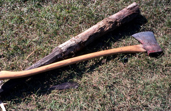 Ax and small piece of white oak used by Lucreaty Clark for basket making (not after 1979)