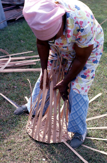 Lucreaty Clark shown making a white oak basket (not after 1979)