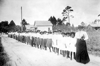 Mary McLeod Bethune with a line of girls from the school (ca. 1905)