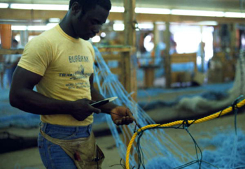 Trawl maker at work at Burbank Trawl Makers: Fernandina Beach, Florida (1982)