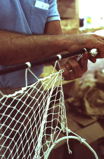Possibly Billy Burbank III weaving a fishing net: Fernandina Beach, Florida (not after 1980)