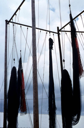 Fishing nets made by Burbank Trawl Makers hanging from pulleys: Fernandina Beach, Florida (not after 1980)