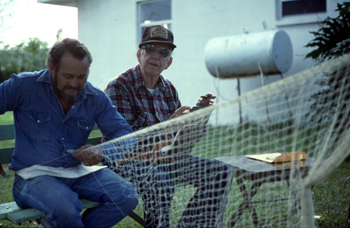 Reginald Reese making a cast net while Max Dooley observes: Lakeland, Florida (1993)
