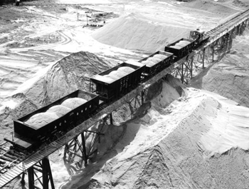 Bird's eye view showing phosphate being shipped, by ACL railroad, to IMC factory for processing: Mulberry, Florida (1947)