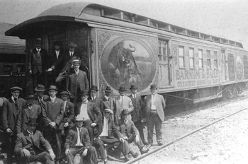Men standing by Barnum & Bailey circus railroad car