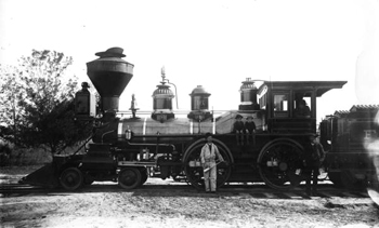 Boys and crew posed with Florida Railway and Navigation Company engine number 16