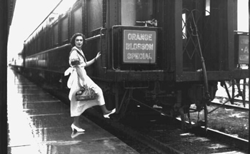 "Unidentified woman boarding the ""Orange Blossom Special"" train: Sebring, Florida (ca. 1930)"